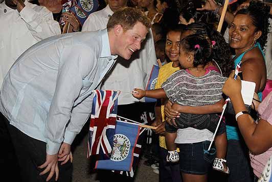 Prince Harry says hello to a little girl in Belize
