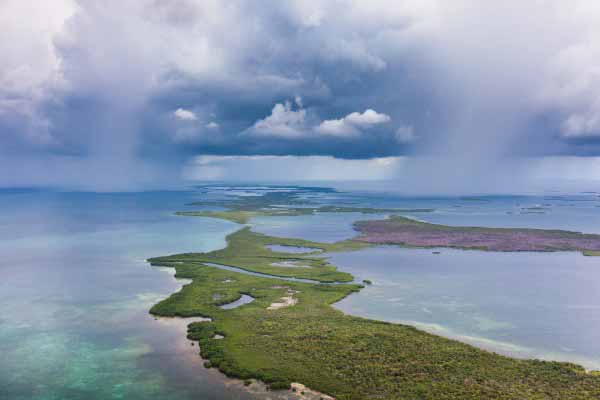 One rainstorm following the other in the Turneffe Atoll, Belize. Tony Rath Photography