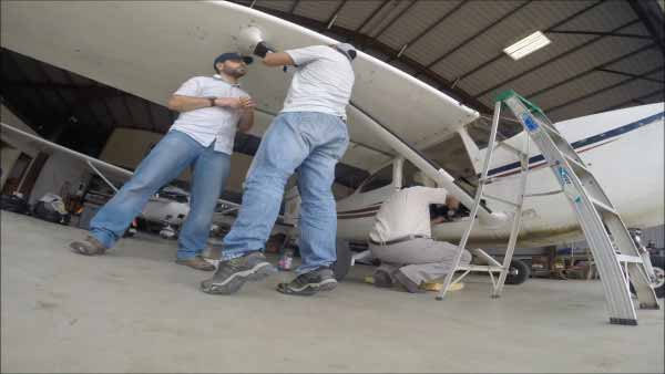 Megaflyover team outfitting their plane with video equipment prior to departure. Photo ©WCS.