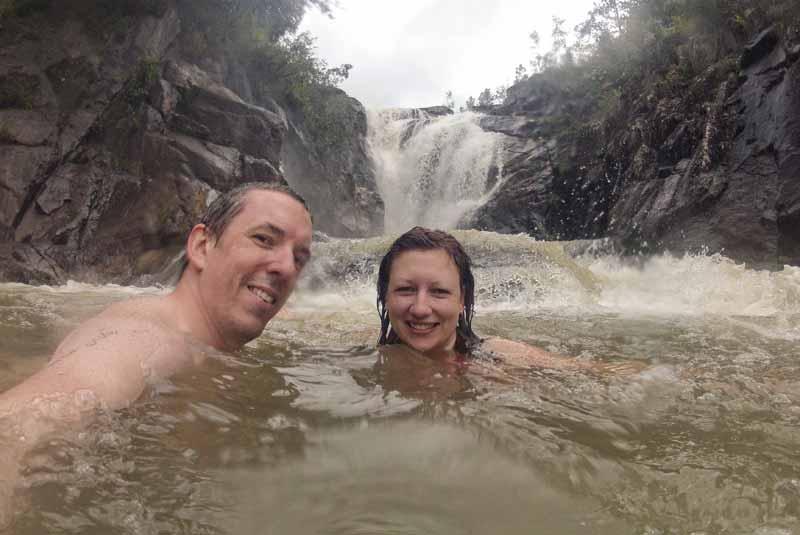 Pete and Dalene swimming near the falls
