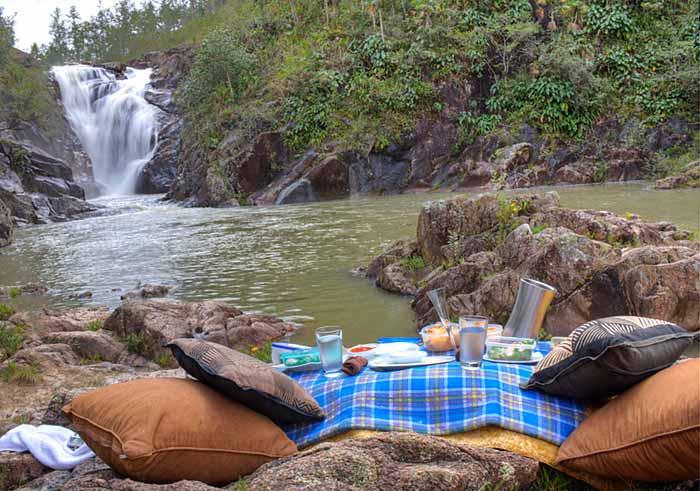 Picnic by a waterfall with Ka'ana Belize