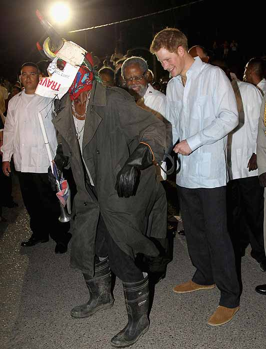 Prince Harry with masked dancer in Belize