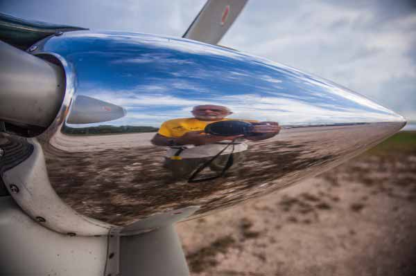 Photographer Tony Rath self portrait with Cessna 206. Tony Rath Photography
