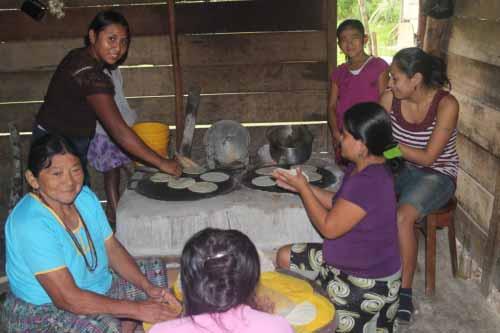 Making and baking the corn tortillas.
