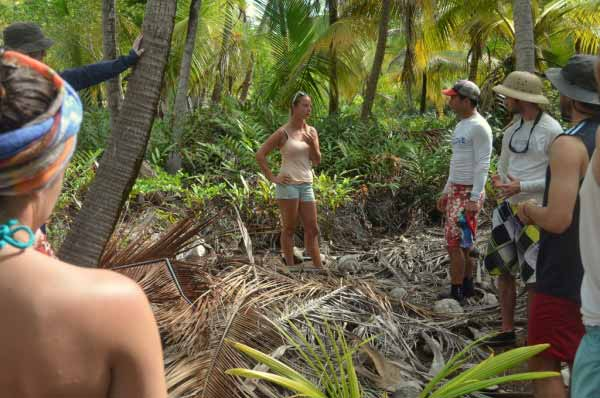 Elizabeth Toleno, whose family has owned Long Caye for nearly 50 years, leads a group of Wake Forest students into the wild interior of the island. Even there you find plastic debris.