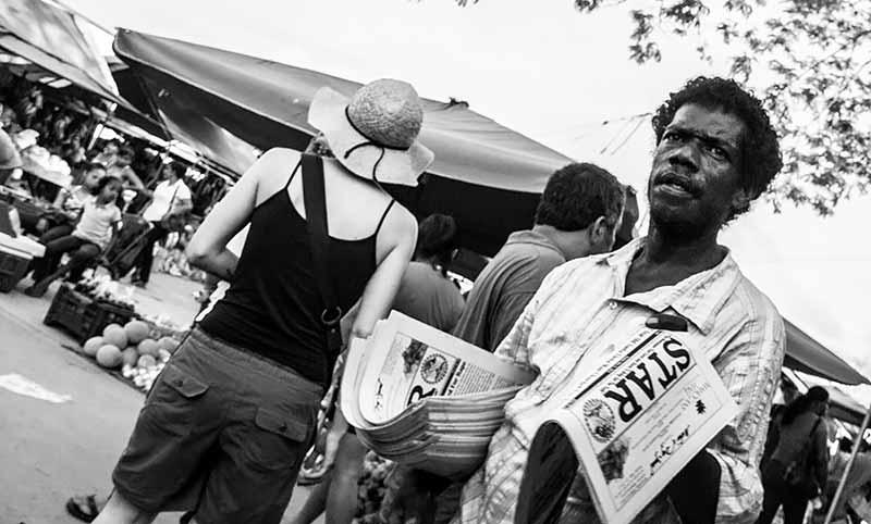 Newspaper vendor in San Ignacio highlights classic Belizean faces!