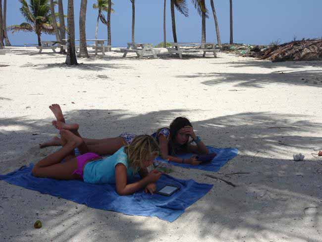 The kids kick back during a relaxing day at Lighthouse Reef.