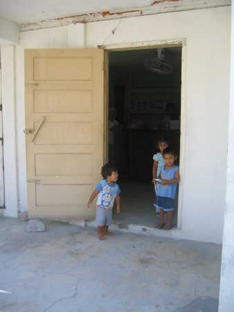 No_idea_in_front_of_which_store..._but_noticed_these_three_kids_in_front_of_what_was_presumably_their_parent's_store..jpg