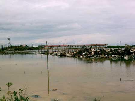 Holy Cross School as seen across lagoon from Reef Village