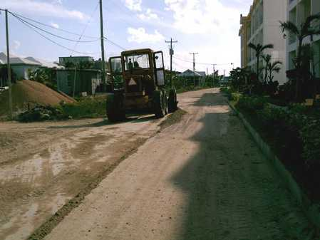 Grader working in front of Reef Village condos.