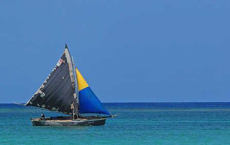 Belize gaff rig sailor in a sandlighter .jpg