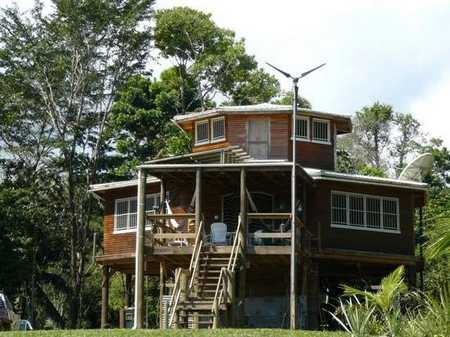 Cherie_and_Vincent_Rose's_home_in_Belize._Their_home_and_crocodile_sanctuary_were_recently_burned_to_the_ground..jpeg