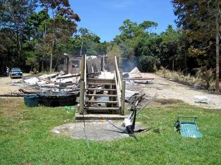 The remains of the Roses' Belize home after an angry mob torched it.