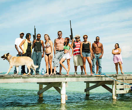 During his time in Belize, McAfee has collected a retinue of bodyguards, dogs, and young women.