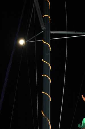 Full Moon above the lighted mast