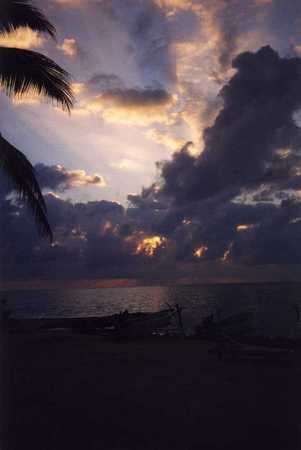 Post-hurricane_beachfront_at_dawn._San_Pedro_Town,_Belize..jpg