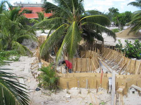 Construction of pool..note island with palm tree in the center. Pretty cool!