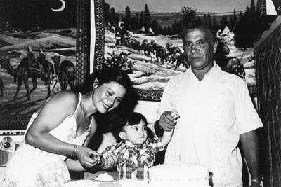 Paisano with his second wife and their adopted child, Habib, at his birthday party.jpg
