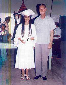Father Raszkowski with graduate