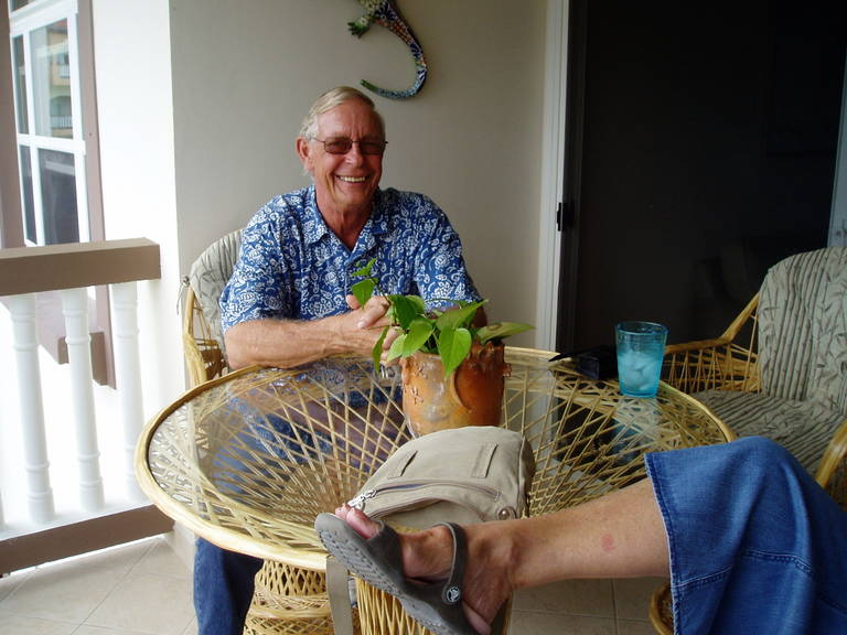 Jim on the patio at their condo at Grand Caribe