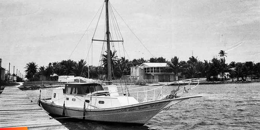 Ray Auxillou's Hideaway Lodge on Caye Caulker (1st hotel on CC) and his boat, the Atoll Queen :: 1960's