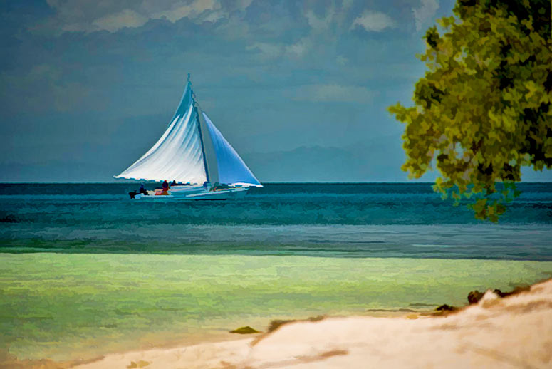 Tropical island vacation scene sailboat at south water caye for Tropical vacations in december